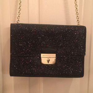 Kate spade New York small black shiny purse with